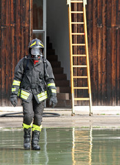 Fireman with the uniform wet after the fire-fighting Services tu