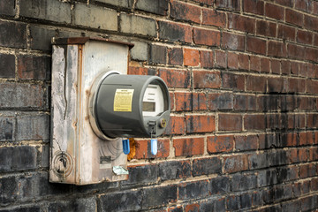 Electric Meter On Old Commercial Building