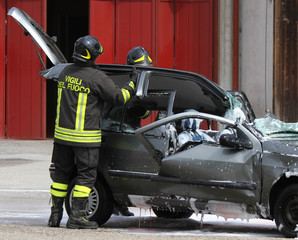 Firefighters open the hood of the car accident