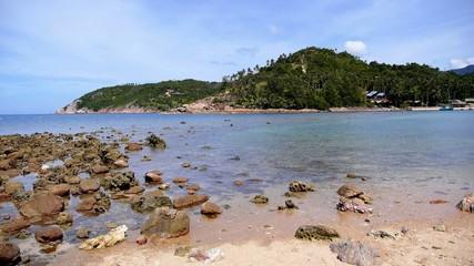 Stony Coast of Beautiful Island with Calm Sea.