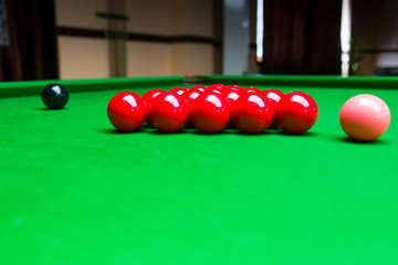 Snooker balls on green pool table