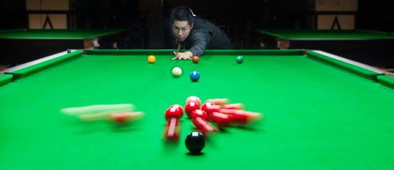 Handsome man playing snooker
