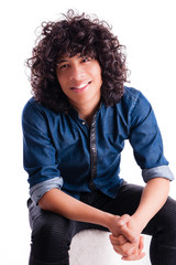Handsome young man with curly hair and a friendly smile