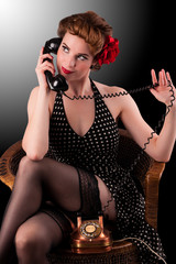 Beautiful young pin-up girl on the telephone.