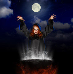 Witch with cauldron on night sky background