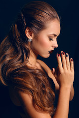 portrait of beautiful girl with dark hair and bright makeup
