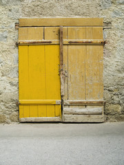 old yellow roll-up door
