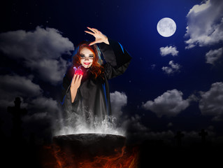 Witch with red potion and cauldron  at night sky backgroun