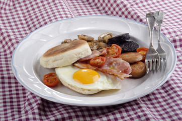 irish breakfast with muffin on a plate