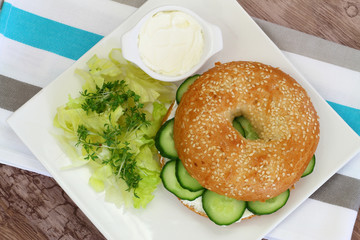 Bagel with cream cheese, cucumber and watercress