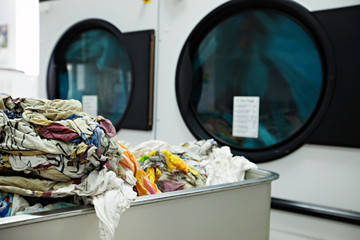 Close-up on heap of dirty laundry in laundromat