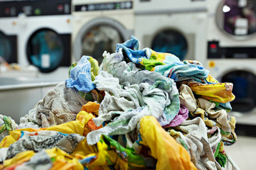 Pile of dirty laundry in laundrette