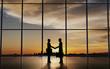 Leinwanddruck Bild - Two Business shake hand silhouettes