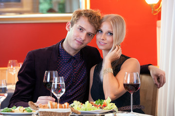 Sweet Young Couple Having Date at Restaurant.