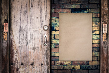 Old paper on the brick wall