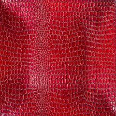 Background of red lacquering crocodile. Concave shape.