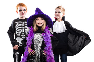 Three halloween characters: witch, skeleton, vampire
