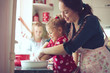 Mother with kids at the kitchen - 71554010