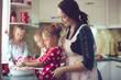 Mother with kids at the kitchen