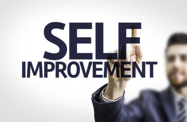 Business man pointing the text: Self Improvement