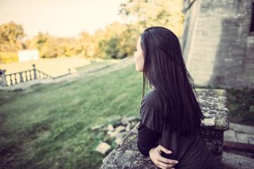 Girl looking forward in old castle