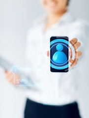 close up of businesswoman showing smartphone