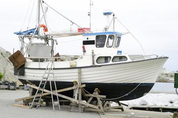 Old ship in dock on repair