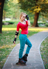 Roller sporty girl in park, woman outdoor fitness activities