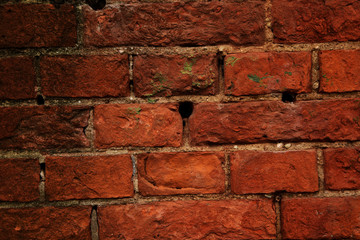The pattern of the wall from red brick