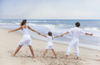 Mother Father Girl Child Family on Beach Holding Hands