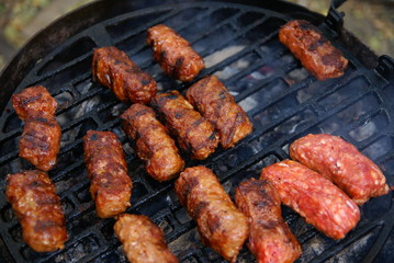 """Traditional romanian outdoor grill  meat  food  - """"Mici """""""