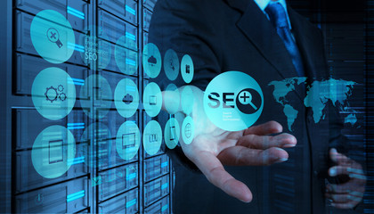 Double exposure of businessman hand showing search engine optimi