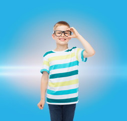 smiling little boy in eyeglasses