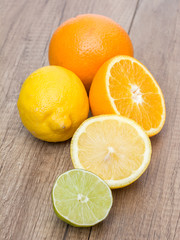 Oranges, Lemons And Lime Fruit On Table