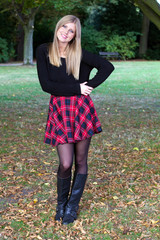 Beautiful young woman posing in park.