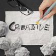hand drawing design word CREATIVE on crumpled paper with as conc
