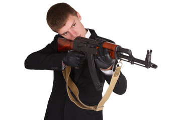 man in black costume and ak 47