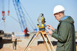 Leinwandbild Motiv surveyor worker with theodolite