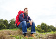 canvas print picture - man with backpack hiking