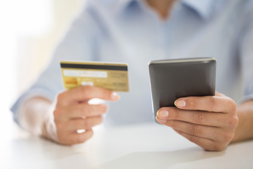 woman is shopping on internet with mobile phone