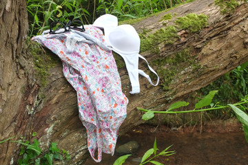 Gone swimming, Young womans clothes left on a tree.