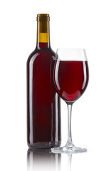 Glass and bottle of red wine isolated on white