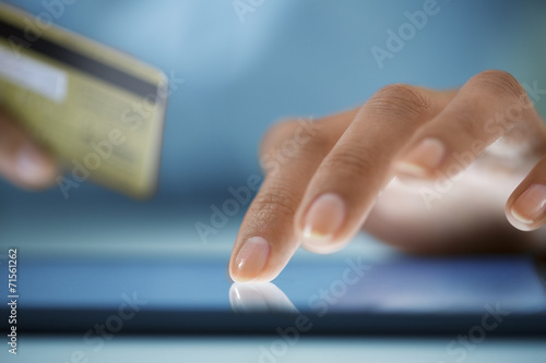 Fototapeta Close-up hand Woman shopping online with digital tablet