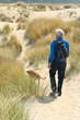 Senior man hiking with dog