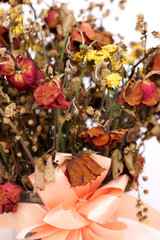 Close up of dried withered roses bouquet.
