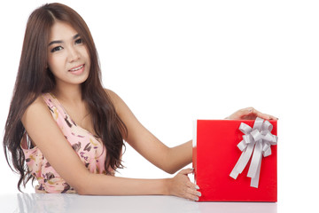 Beautiful Asian woman with red gift box