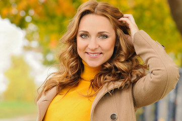 portrait of beautiful attractive smiling young woman in autumn p