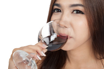 Close up of Beautiful Asian woman drink red wine