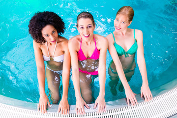Women swimming in pool