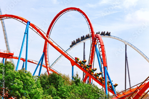 Foto op Canvas Mediterraans Europa Roller Coaster in funny amusement park